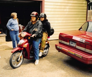 Leslie and Rachel head out on the scooter